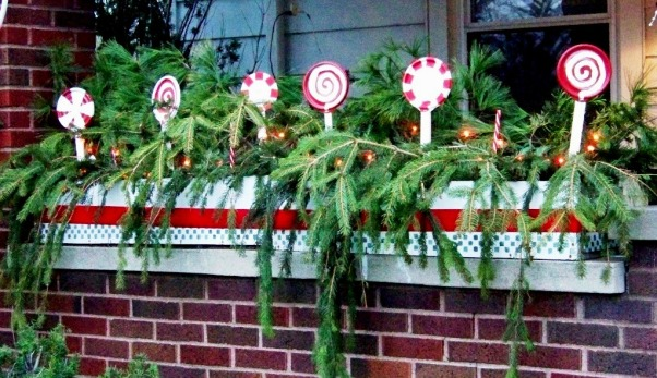 Sweet Christmas 2011, My outdoor Christmas decorating this year took a sweet turn.  Inspired by candy canes, peppermints and lollipops, I couldn't be happier with the results.  A lot of the decorations were handmade and handpainted.  I hope you enjoy!!  Merry Christmas , Pine branches and handmade peppermint lollipops fill the flower boxes along the front porch.  A red velvet ribbon around the white flower box give it a splash of color!, Holidays Design