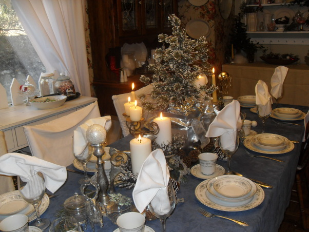 Holiday Tablescapes, Dining room in our farmhouse, Blue and white tablescape, china, white candles and reindeer, with silver reindeer and garland, Holidays Design