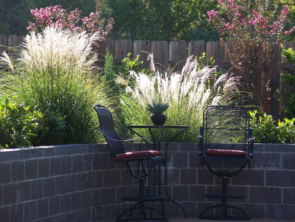 Backyard Makeover, The backyard was fenced in with a pool but needed a design.  we did a complete makeover with a pergola over the original patio. , Fountain Grass sitting area by pool, Yards Design