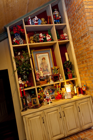 Country French Christmas, Country French Christmas by Show me Decorating, cool turquoise, rich red and gold compliment the season in this beautiful home., bookcases show off Mr and Mrs. santa Claus collection, antique seed poster, Holidays Design