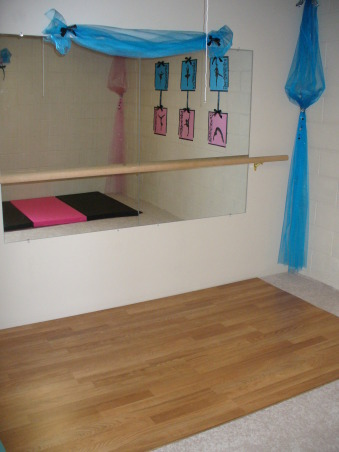 dance and gymnastic room, This is a room in our unfinished basement that we transformed into our daughters' own dance and gymnastic practice room as a Christmas present., The room includes a wood floor, large wall mirrors and ballet bar for dance practice and a gym mat for our little gymnastics lover.       , Girls' Rooms Design