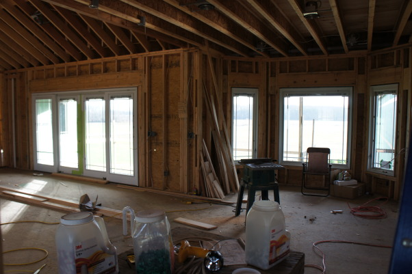 Still a work in Progress, This was a new construction and we have moved in ... the room still needs some life breathed into it ... BUT we have some great starting points, Great Room sliding glass doors on left, breakfast nook on right   , Living Rooms Design