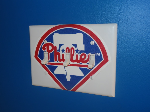 "Phillies ""phan"" bedroom for a 6 year old boy, After having lived in Philly for just over a year, my 6 year old son wanted a Phillies room.  He was delighted with how it turned out., I had gotten a small package of Phillies Fatheads for decoration in the room...this was kind of fun to spruce up the switchplate., Boys' Rooms Design"