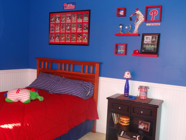 "Phillies ""phan"" bedroom for a 6 year old boy, After having lived in Philly for just over a year, my 6 year old son wanted a Phillies room.  He was delighted with how it turned out., Using a set of larger team baseball cards, we created a ""poster"" of this years players to place above the bed.  We also used some red shelves from Target and created a display on the wall with some Fatheads and a few other small items.  , Boys' Rooms Design"