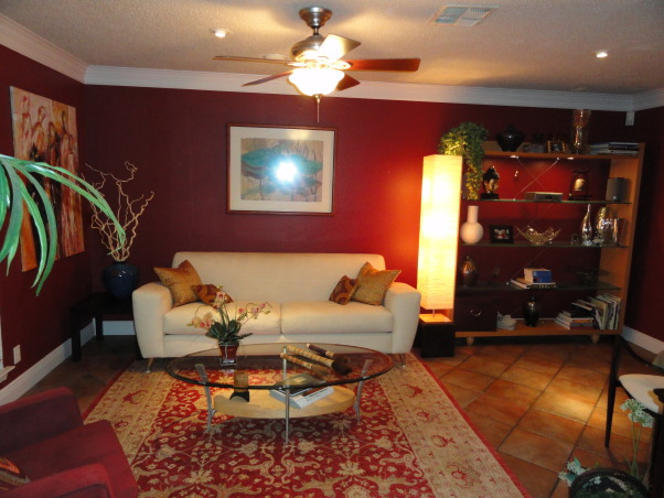 Burgundy Living Room, Burgundy walls, cream sofa, gold accents. Contemporary with Asian accessories., I have the hardest time arranging shelves.  , Living Rooms Design