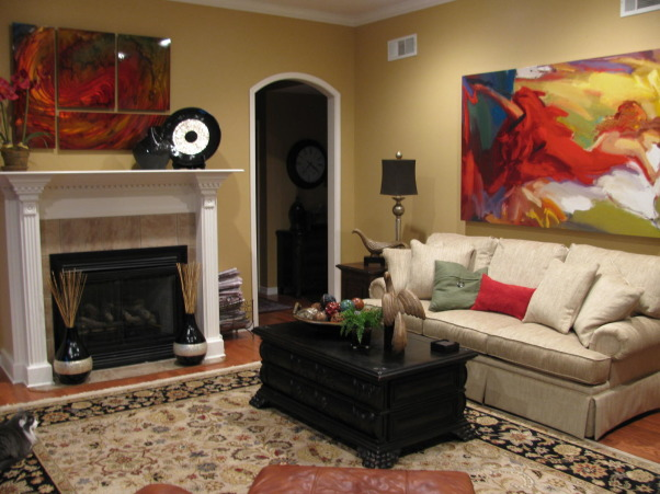 Traditional with a Modern Twist, New art and a new couch update my traditional living room., Added a few colorful pillows. , Living Rooms Design