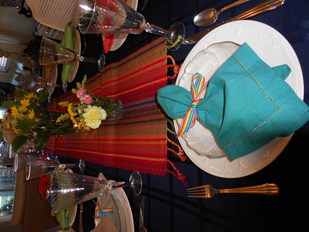 Mexican Dinner Party, I recently had a Mexican Dinner Party  I used things I had in the house and bought a runner at Pier 1---Then tied the napkins with striped ribbon. Used tea lights in different colors .  It was a fun night and everyone had a good time., Dining Rooms Design