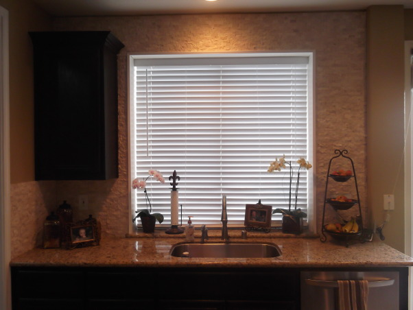 DIY Kitchen Remodel, We completely transformed our old builder grade kitchen by painting the oak cabinets(with rustoleum cabinet transformation kit) a rich chocolate color and adding crown molding. We replaced the countertops with granite, and added a new sink and faucet. We also put in a split face travertine mosaic tile backsplash as well as redid the flooring in a versaille pattern with ceramic tile. The only thing we contracted out was the granite., We decided to do the backsplash all the way up the wall as a nice accent. , Kitchens Design