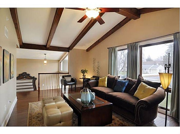 Exterior Help Request - 1970's Split Level, Just purchased this home.  While the interior was remodeled in 2008, the exterior needs a personality lift.  Suggestions welcome! :), Living room (photo is by the realtor).  I like it's exposed beams.  , Home Exterior Design