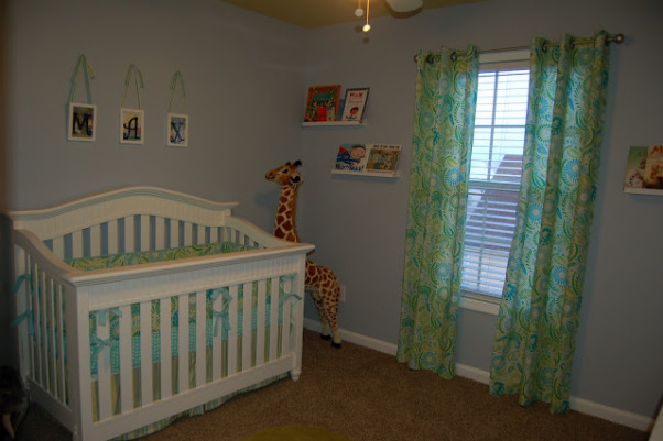 Max's Where the Wild Things Are Jungle Nursery, Baby Boy Nursery with Blue, Aqua and Lime Green Nursery featuring the theme from the children's book Where the Wild Things Are.  Room color- is painted Iced slate by Benjamin Moore (we used the Natura paint with zero VOC). Crib- is BabiItalia Eastside Lifestyle Classic in White, sold at Babies R Us.  Curtains- My mom created grommet curtains with the same fabric that was used in the crib bedding. I like it since we have to take out the bumper (safety issues) so we will still have that pretty fabric in the room. The grommets and curtain rod are from Joann Fabrics.  I purchased the fabric via amazon.  Crib bedding- was customized and made by a talented Etsy shop owner, Cottage Belles.  Max letters above crib- were created by my sister and used scenes from Where the Wild Things Are books in the background. Giraffe and elephant- were purchased from Amazon. Lime green circles rug circles- were purchased at IKEA.  Book Shelf Holders- are actually picture frame ledges that we bought at IKEA.  Max name books- were thought of by my talented sister and purchased via Amazon Glider- Little Castle Enchanted Embassy Glider Plush Taupe Glider and Ottoman from walmart.com Closet- The shelves, drawers and baskets came from IKEA.  Closet Paint Color- Valspara Can not Miss Lime from Lowes. The clothes hanging rods came from Lowes. More details- http://davidandjenw.blogspot.com/search/label/Nursery, Nurseries Design