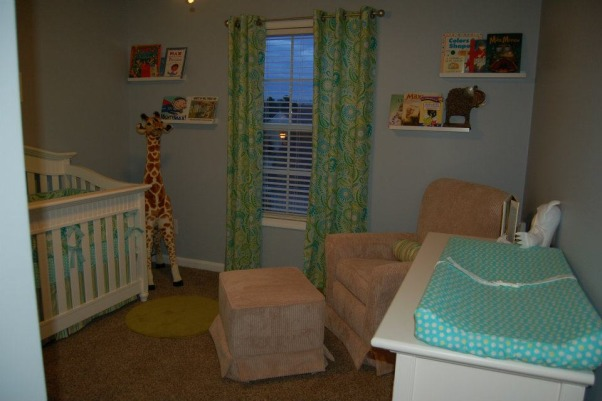 Max's Where the Wild Things Are Jungle Nursery, Baby Boy Nursery with Blue, Aqua and Lime Green Nursery featuring the theme from the children's book Where the Wild Things Are.  Room color- is painted Iced slate by Benjamin Moore (we used the Natura paint with zero VOC). Crib- is BabiItalia Eastside Lifestyle Classic in White, sold at Babies R Us.  Curtains- My mom created grommet curtains with the same fabric that was used in the crib bedding. I like it since we have to take out the bumper (safety issues) so we will still have that pretty fabric in the room. The grommets and curtain rod are from Joann Fabrics.  I purchased the fabric via amazon.  Crib bedding- was customized and made by a talented Etsy shop owner, Cottage Belles.  Max letters above crib- were created by my sister and used scenes from Where the Wild Things Are books in the background. Giraffe and elephant- were purchased from Amazon. Lime green circles rug circles- were purchased at IKEA.  Book Shelf Holders- are actually picture frame ledges that we bought at IKEA.  Max name books- were thought of by my talented sister and purchased via Amazon Glider- Little Castle Enchanted Embassy Glider Plush Taupe Glider and Ottoman from walmart.com Closet- The shelves, drawers and baskets came from IKEA.  Closet Paint Color- Valspara Can not Miss Lime from Lowes. The clothes hanging rods came from Lowes. More details- http://davidandjenw.blogspot.com/search/label/Nursery, The room from the door , Nurseries Design