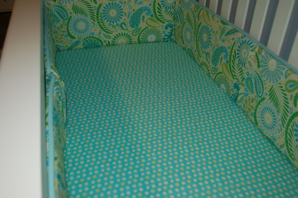 Max's Where the Wild Things Are Jungle Nursery, Baby Boy Nursery with Blue, Aqua and Lime Green Nursery featuring the theme from the children's book Where the Wild Things Are.  Room color- is painted Iced slate by Benjamin Moore (we used the Natura paint with zero VOC). Crib- is BabiItalia Eastside Lifestyle Classic in White, sold at Babies R Us.  Curtains- My mom created grommet curtains with the same fabric that was used in the crib bedding. I like it since we have to take out the bumper (safety issues) so we will still have that pretty fabric in the room. The grommets and curtain rod are from Joann Fabrics.  I purchased the fabric via amazon.  Crib bedding- was customized and made by a talented Etsy shop owner, Cottage Belles.  Max letters above crib- were created by my sister and used scenes from Where the Wild Things Are books in the background. Giraffe and elephant- were purchased from Amazon. Lime green circles rug circles- were purchased at IKEA.  Book Shelf Holders- are actually picture frame ledges that we bought at IKEA.  Max name books- were thought of by my talented sister and purchased via Amazon Glider- Little Castle Enchanted Embassy Glider Plush Taupe Glider and Ottoman from walmart.com Closet- The shelves, drawers and baskets came from IKEA.  Closet Paint Color- Valspara Can not Miss Lime from Lowes. The clothes hanging rods came from Lowes. More details- http://davidandjenw.blogspot.com/search/label/Nursery, Crib sheet and bumper , Nurseries Design