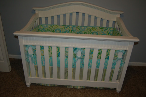 Max's Where the Wild Things Are Jungle Nursery, Baby Boy Nursery with Blue, Aqua and Lime Green Nursery featuring the theme from the children's book Where the Wild Things Are.  Room color- is painted Iced slate by Benjamin Moore (we used the Natura paint with zero VOC). Crib- is BabiItalia Eastside Lifestyle Classic in White, sold at Babies R Us.  Curtains- My mom created grommet curtains with the same fabric that was used in the crib bedding. I like it since we have to take out the bumper (safety issues) so we will still have that pretty fabric in the room. The grommets and curtain rod are from Joann Fabrics.  I purchased the fabric via amazon.  Crib bedding- was customized and made by a talented Etsy shop owner, Cottage Belles.  Max letters above crib- were created by my sister and used scenes from Where the Wild Things Are books in the background. Giraffe and elephant- were purchased from Amazon. Lime green circles rug circles- were purchased at IKEA.  Book Shelf Holders- are actually picture frame ledges that we bought at IKEA.  Max name books- were thought of by my talented sister and purchased via Amazon Glider- Little Castle Enchanted Embassy Glider Plush Taupe Glider and Ottoman from walmart.com Closet- The shelves, drawers and baskets came from IKEA.  Closet Paint Color- Valspara Can not Miss Lime from Lowes. The clothes hanging rods came from Lowes. More details- http://davidandjenw.blogspot.com/search/label/Nursery, Crib bedding , Nurseries Design
