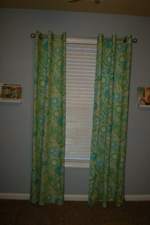 Max's Where the Wild Things Are Jungle Nursery, Baby Boy Nursery with Blue, Aqua and Lime Green Nursery featuring the theme from the children's book Where the Wild Things Are.  Room color- is painted Iced slate by Benjamin Moore (we used the Natura paint with zero VOC). Crib- is BabiItalia Eastside Lifestyle Classic in White, sold at Babies R Us.  Curtains- My mom created grommet curtains with the same fabric that was used in the crib bedding. I like it since we have to take out the bumper (safety issues) so we will still have that pretty fabric in the room. The grommets and curtain rod are from Joann Fabrics.  I purchased the fabric via amazon.  Crib bedding- was customized and made by a talented Etsy shop owner, Cottage Belles.  Max letters above crib- were created by my sister and used scenes from Where the Wild Things Are books in the background. Giraffe and elephant- were purchased from Amazon. Lime green circles rug circles- were purchased at IKEA.  Book Shelf Holders- are actually picture frame ledges that we bought at IKEA.  Max name books- were thought of by my talented sister and purchased via Amazon Glider- Little Castle Enchanted Embassy Glider Plush Taupe Glider and Ottoman from walmart.com Closet- The shelves, drawers and baskets came from IKEA.  Closet Paint Color- Valspara Can not Miss Lime from Lowes. The clothes hanging rods came from Lowes. More details- http://davidandjenw.blogspot.com/search/label/Nursery, Curtains , Nurseries Design