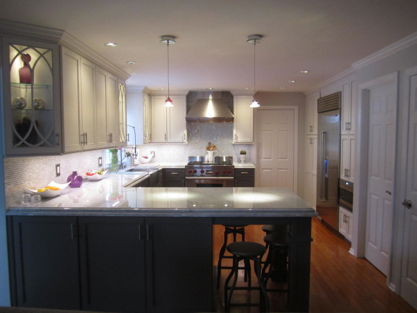 Vintage Modern , Modern amenities meet vintage charm, Marble double stacked countertops, hand finished, glazed cabinets and glass tile backsplash with stainless steel appliances and accents.  Crystal drop pendants., Kitchens Design