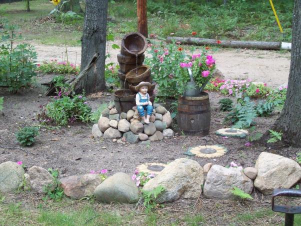 rock edged flower bed..., rock edged flower bed, fountain, Yards Design