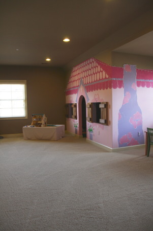 The Ultimate Playroom!, This space is our children's playroom. This playroom is for both boys and girls - and even fun-loving adults!, Your first view as you come upstairs - this adorable pink playhouse! I also converted an old Thomas Train table into a doll house for our 2 year old!  www.besimplyorganized.blogspot.com, Other Spaces Design