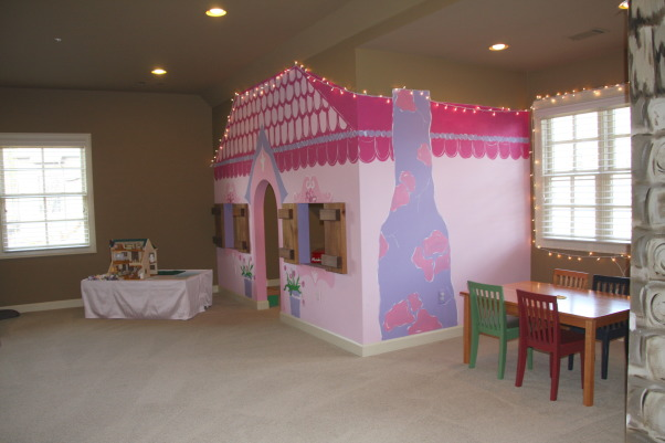 The Ultimate Playroom!, This space is our children's playroom. This playroom is for both boys and girls - and even fun-loving adults!, The pink house is painted to look like a little cottage. I put the white lights up during the Holidays, but the kids wanted to keep them up long after their little Christmas tree came down. Makes it look a little more charming with the lights. , Other Spaces Design