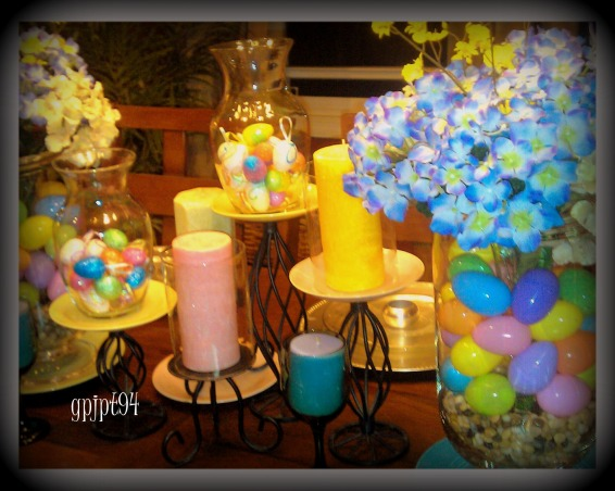 Pretty pastel plates pull Easter table together, My dinning room table this Easter. I used pastel dessert plates from the dollar store to pull this look all together. By placing a vase inside of the glass urns, I was able to put plastic eggs around the vase and still have a floral display on the table.  , Holidays Design