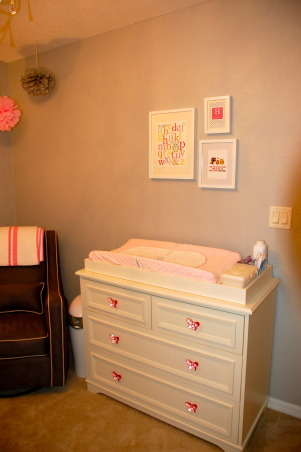 Pink & Grey Baby Girl Nursery, We love our pink and grey nursery! Most of the items are from Pottery Barn Kids.  The crib is the Madison 3 in 1 fixed gate crib from Pottery Barn kids.  The dresser is the Filmore Dresser from Pottery Barn Kids. Butterfly Knobs are sold there separately.   Bedding is from Pottery Barn Kids.   The tree decal and pom poms are from Etsy.  The glider is from Babies R US.  Wall Paint is Light French Gray by Sherwin Williams.   The wooden H above the crib is from craftcuts.com - we painted it Pink.   Art work- prints are from Etsy, but frames are from IKEA. Dog on chair is also from IKEA.  Polka dots in closet are from Etsy and are decals.   Nightstand and lamp are from Pottery Barn Kids.   ENJOY and just comment if you have other questions! :-) , Nurseries Design