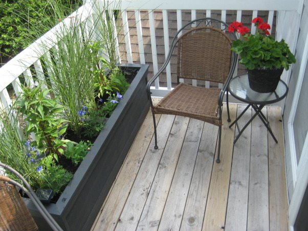 Condo Balcony Planter, My boyfriend made me some unique planters for my patio. The tall grasses block the street view., Wooden planter stained black., Patios & Decks Design
