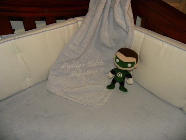 """Vintage Superhero Baby, We had never seen anyone else do a super hero nursery and we decided our boy deserved the first!!! Much hard work and it came to be :), Pottery barn blanket that says """"Daddys Little Superhero"""" The super hero plushies were perfect also. , Nurseries Design"""