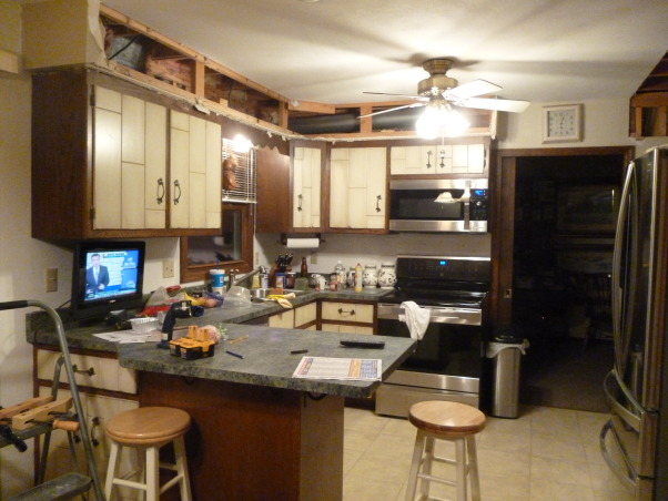 Kitchen Makeover, Kitchen makeover with cherry cabinets (coffee color), granite and glass-natural stone back splash., Demolition of old kitchen., Kitchens Design