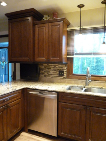 Kitchen Makeover, Kitchen makeover with cherry cabinets (coffee color), granite and glass-natural stone back splash., A TV is a must., Kitchens Design