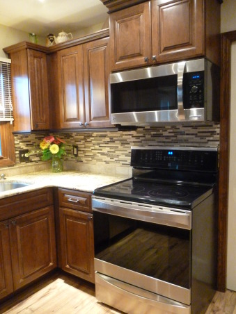 Kitchen Makeover, Kitchen makeover with cherry cabinets (coffee color), granite and glass-natural stone back splash., Appliances that match., Kitchens Design