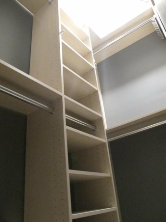 UES Walk-in Closet , Small Walk-in closet before and afters. The challenge was to work around an existing none working  door in the space. The closet walls were painted gray to add a sense of depth to the closet, and to bring out the tones of the melamine. , AFTER: created hanging space and adjustable shelving. Included an extra rod just in case client needs more hanging. , Closets Design