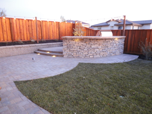 Outdoor Bar, Fire Pit, and Mini Vineyard, This is my husband's dream backyard.  It includes an outdoor bar & cooking area, BBQ, fire pit, & mini vineyard.  One day we will have patio furniture and chairs by the fire pit, but one thing at a time!, bar & cooking area           , Yards Design