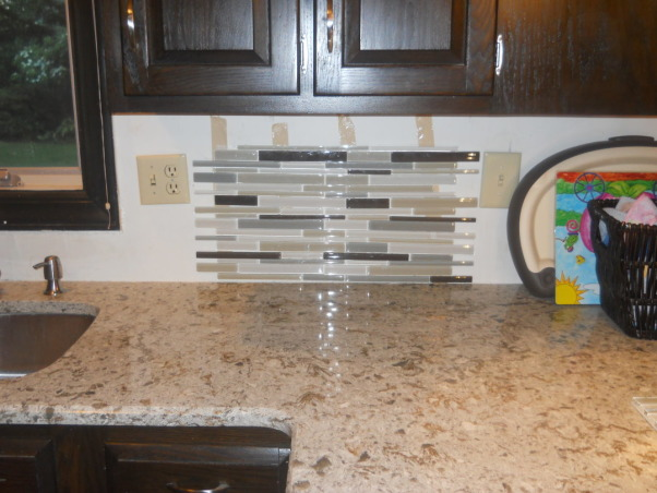 Please help us with our glass mosaic backsplash and quartz countertops!, We were looking at these tile options for backsplash but now feel it will be too busy with quartz windermere counters.  We can use the mosaic with or without the dark brown as seen in pictures or we've thought about using the mosaic with 2 or 3 rows of subway tile below it.  Advice?, mosaic glass tile with brown, Kitchens Design