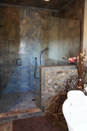 "Nature's Inspiration, My husband and I love the outdoors ... and we wanted to bring it inside so we could enjoy it everyday, shower designed to look like a waterfall, clear glitter grout through ""water"" tile and rock covered half wall , Bathrooms Design"