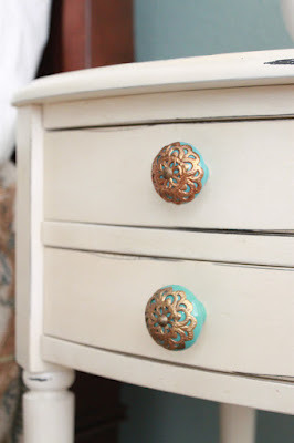 Modern Country Master Bedroom, My clean, modern, country, master bedroom.  A patterned duvet, deep aqua wall color, gallery wall, and fun modern accents., I switched out the hardware on the nightstands for these lovely knobs from Anthropologie. , Bedrooms Design