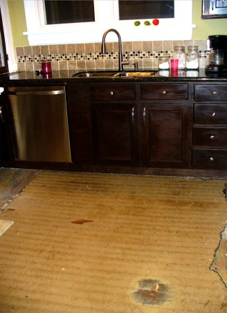 Reclaimed Kitchen, My husband and I rescued these cabinets from being thrown in the trash. We sanded, stained, added new doors and hardware and modified them to fit our kitchen and installed a new back splash. We got the granite at a wholesale outlet, the sink and faucet on sale at Lowes. The biggest cost was refinishing the wood floor after we discovered it under layers of glue and linoleum. Our kitchen was low cost, lots of labor but worth it! PLEASE VIEW ALL PICS AND GIVE US YOUR COMMENTS...we welcome them! The BEFORE pictures of our kitchen can be viewed under lifetimedvd1 pictures. THANK YOU!, The first sign of wood under layers of linoleum , Kitchens Design
