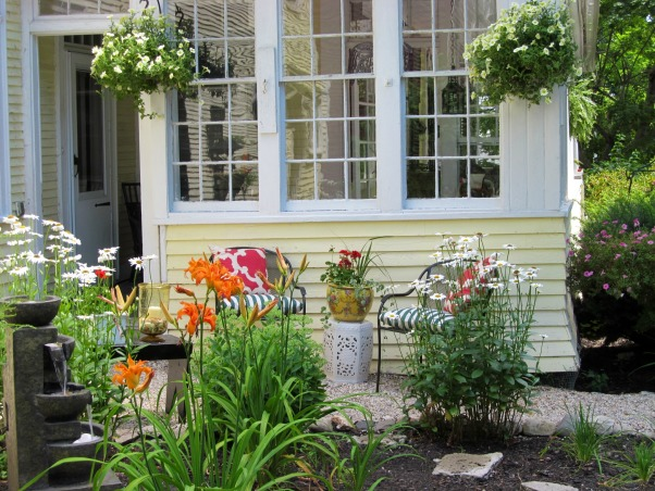 In Town Oasis, One block from the center of town, we have created an alternative to our front porch., a fountain, some pea stone and a few perennials turned an unused space into an in town oasis,, Gardens Design