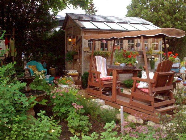 My garden and potting shed, Hello! I decide to share with you photos of my garden and potting place. When we first bought the house, there was NOTHING outside...so, with a friend we made plans and made all the garden...the potting shed was made with the help of 7 good friends...hope you enjoy looking at these! Margot, from Quebec, Another point of view where we can see the glider and the potting shed, and the fountain  , Gardens Design