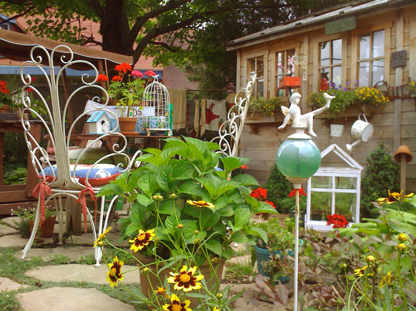 My garden and potting shed, Hello! I decide to share with you photos of my garden and potting place. When we first bought the house, there was NOTHING outside...so, with a friend we made plans and made all the garden...the potting shed was made with the help of 7 good friends...hope you enjoy looking at these! Margot, from Quebec, My little garden  , Gardens Design