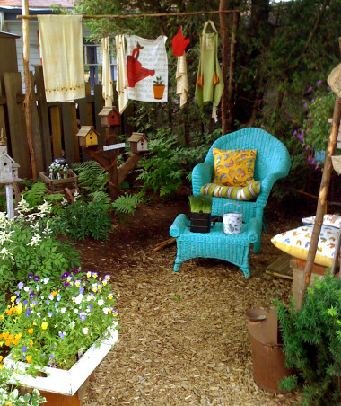 My garden and potting shed, Hello! I decide to share with you photos of my garden and potting place. When we first bought the house, there was NOTHING outside...so, with a friend we made plans and made all the garden...the potting shed was made with the help of 7 good friends...hope you enjoy looking at these! Margot, from Quebec, The corner of the garden! I hang up some garden clothing to make a privacy between me and the neighbor  , Gardens Design