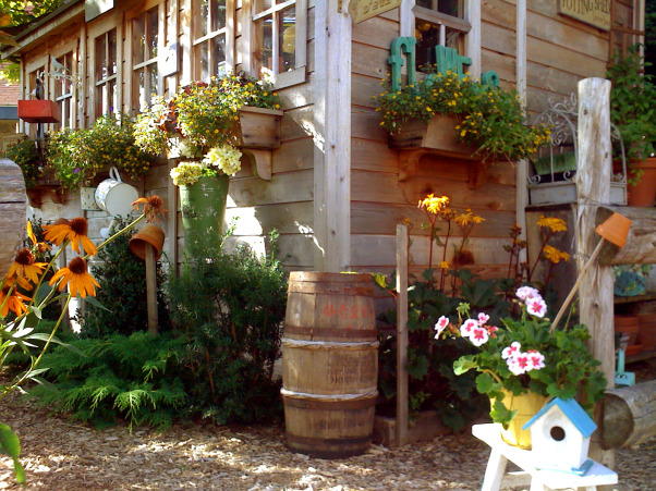 My garden and potting shed, Hello! I decide to share with you photos of my garden and potting place. When we first bought the house, there was NOTHING outside...so, with a friend we made plans and made all the garden...the potting shed was made with the help of 7 good friends...hope you enjoy looking at these! Margot, from Quebec, A little corner of the potting shed, with the old barrel to recuperate water  , Gardens Design