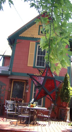VICTORIAN  FARMHOUSE RENOVATION, This is my old Victorian  farmhouse redo. It's a sort of recycled repurposed story.The colors I chose were from Pratt and Lambert paint. The roof is a steel  cedar shake molded interlock system with a copper finish. The weather vane and lightning rods are all copper with glass globes., back of the house , Home Exterior Design