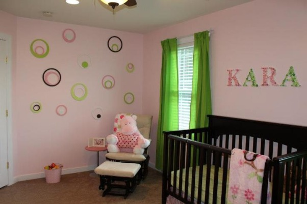 Pink & Green Paradise for Pint-Sized Princess, We wanted a room that was still very girly for our little girl, but also a little more fun for a growing toddler (who happens to love the color green). , She loves shapes, especially circles -- so I painted a bunch of white circles the colors of the room and hung them in one corner., Nurseries Design