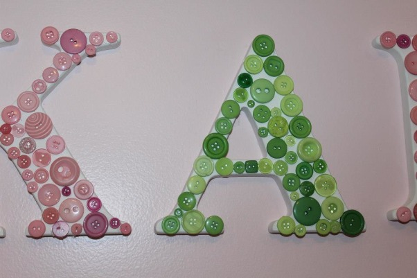 Pink & Green Paradise for Pint-Sized Princess, We wanted a room that was still very girly for our little girl, but also a little more fun for a growing toddler (who happens to love the color green). , An easy way to make boring letters more interesting is by using a hot glue gun to add buttons., Nurseries Design