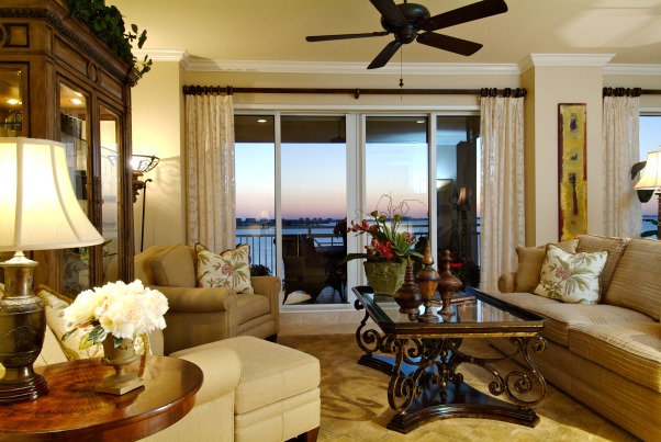Long View Living, This living room on the 14th floor has wonderful long views of the Sarasota Bay.  I definitley wanted to keep that incorporated and work with a very long and narrow space.  I split the space up into 2 sererate space/conversation areas but kept the sight lines open. , Living Room, Living Rooms Design