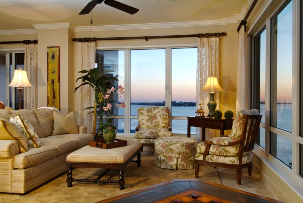 Long View Living, This living room on the 14th floor has wonderful long views of the Sarasota Bay.  I definitley wanted to keep that incorporated and work with a very long and narrow space.  I split the space up into 2 sererate space/conversation areas but kept the sight lines open. , Living Rooms Design