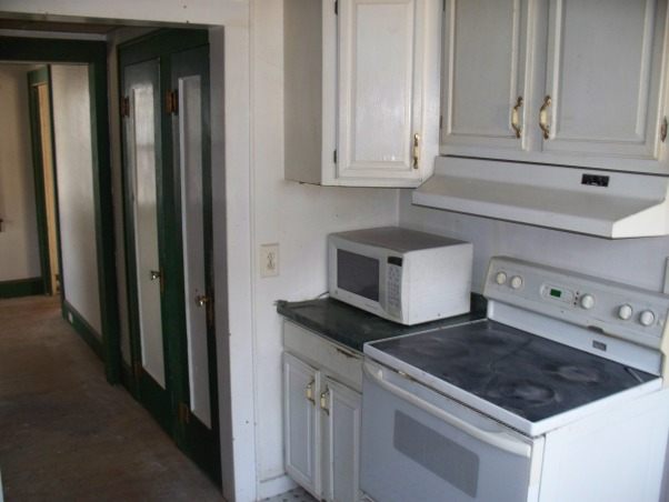 Hacketts House Kitchen Remodel, My husband and I have completed some small scale remodels over the last year.  This investment property was a wrecked foreclosure and needed a complete remodel. It's the biggest project we've taken on to date and our first ever flip. Now that's its complete and on the market, I wanted to share it here with all of you., Kitchen had three entrances. One to the dining room, another to a mudroom that leads out to deck and another door to a hallway bath that was also accessible through a main floor bedroom.  We chose to close off the hallway door and recess the stove.  This helped conserve much needed floor space. The wall pictured was opened up to the dining area and created a breakfast bar with additional seating., Kitchens Design