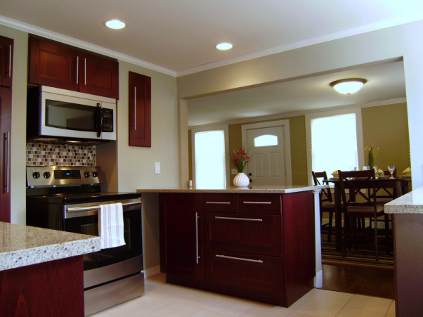 Hacketts House Kitchen Remodel, My husband and I have completed some small scale remodels over the last year.  This investment property was a wrecked foreclosure and needed a complete remodel. It's the biggest project we've taken on to date and our first ever flip. Now that's its complete and on the market, I wanted to share it here with all of you., We've recessed the wall cabinets which went a long way in keeping the space visually uncluttered and open.  The stainless steel appliances were purchased locally.  Here you can see how opening a wall makes a dramatic difference to a kitchen layout.  Warm neutral colors used throughout the house to blend one room into another., Kitchens Design