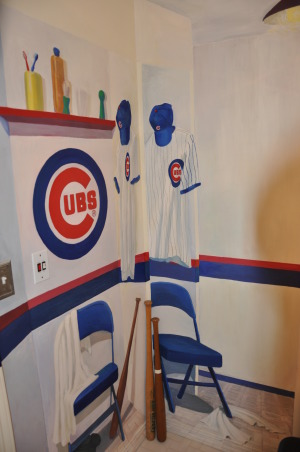 "Boys Baseball bathroom , We're Cubs fans... condolences PLEASE! Once a Cubs Fan always a Cubs fan. The tradition of dying of old age waiting for a Cubs WS continues. In the interim we  turned our son's  bathroom into the Cubs locker room. Ernie Bank's locker is just across from our son's..talk abotu fantasy ball.  The mural  is complete with shoes and socks strewn so that  our son's own dirty socks on the floor won't stand out so much.   The design  was intended to visually extend what is a small bathroom.  ,  The mural design  extends the room  making the walls  appear to have more depth than they actually have. This  has made a small bathroom ""feel""  larger. , Boys' Rooms Design"