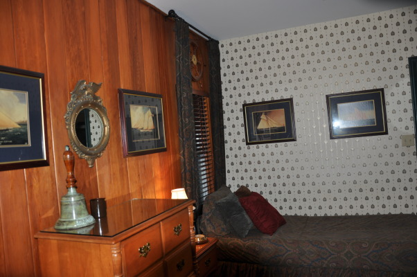 Older Boys Bedroom , Bed room for older son in a 1934 Cape Cod. Wood walls and floors original to house.  Worked in a nautical theme. , Boys' Rooms Design