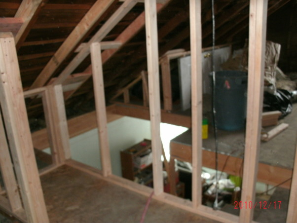 Attic Remodel, A fairly large attic is being converted into a Office/Craft/Den, a Bathroom, Bedroom and storage. Walls are up, all wired, insulation is done, working on sheet rock, (hard to do with 1 and 1/2 arms). Will have built in desk, sewing table and craft storage. , wall from inside bathroom, this bath is over main house full bath , Other Spaces Design